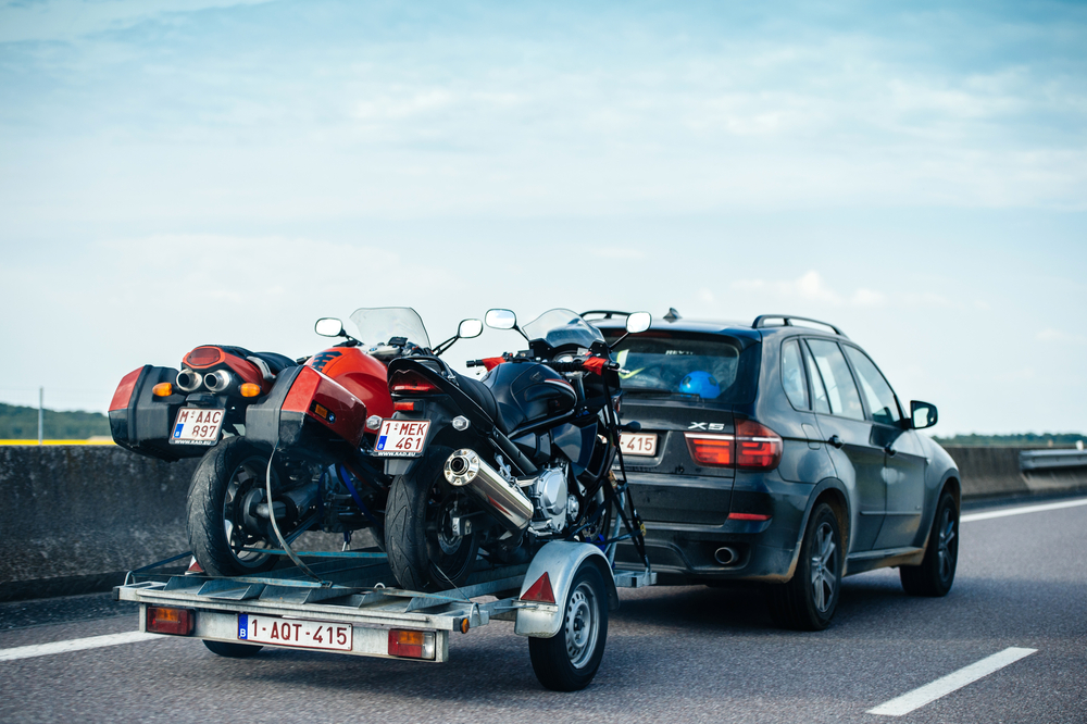 Colorful BMW suv X5 driving fast on French highway with trailer